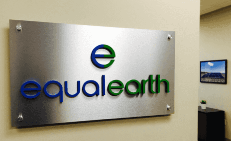 An aluminum lobby sign with individual dimensional letters applied to the surface. Company logotype and logo and are custom painted in bright colors. Also standard brushed aluminum hardware in the corners for mounting on lobby wall.